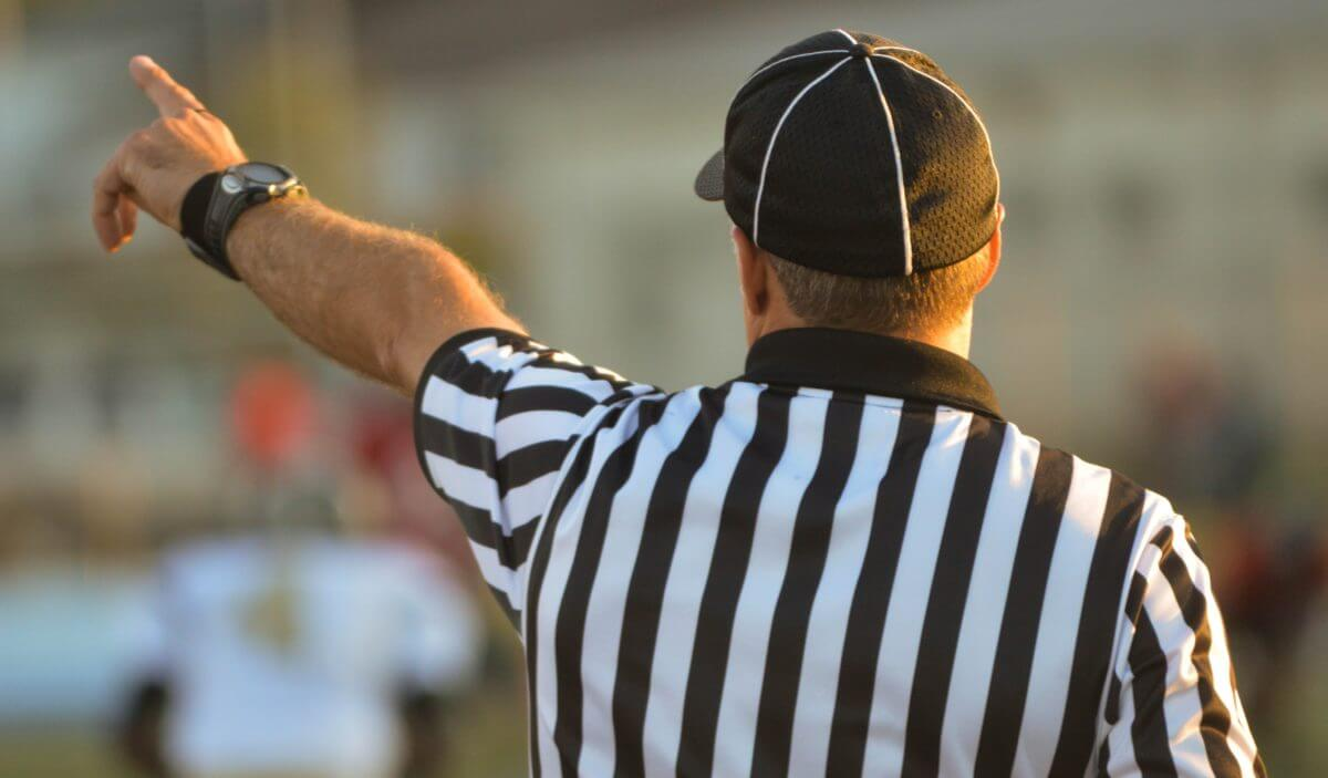 Referee blowing a whistle