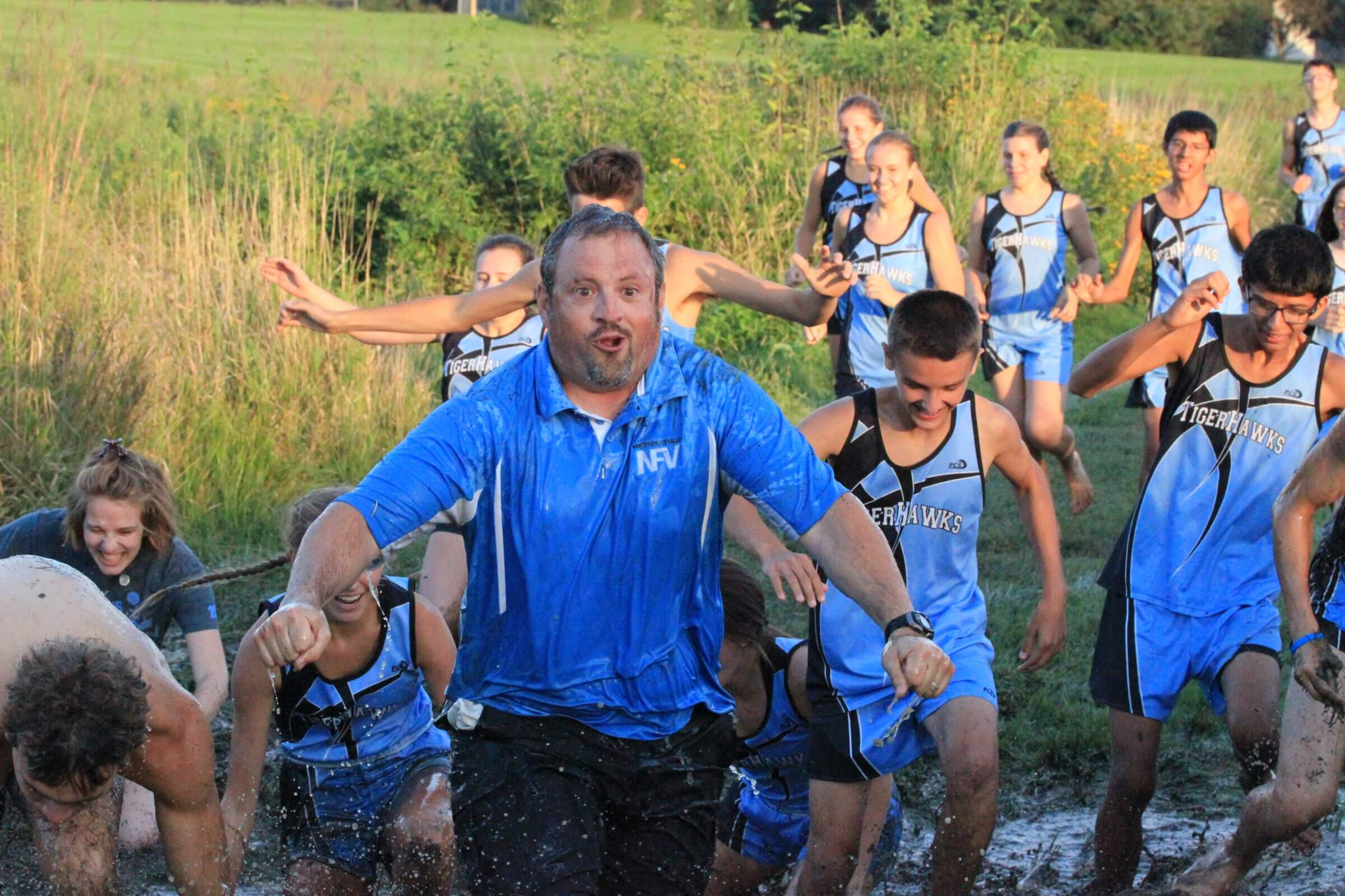 TigerHawk Cross Country Runner with Coach